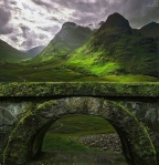 Stone arch and green hills